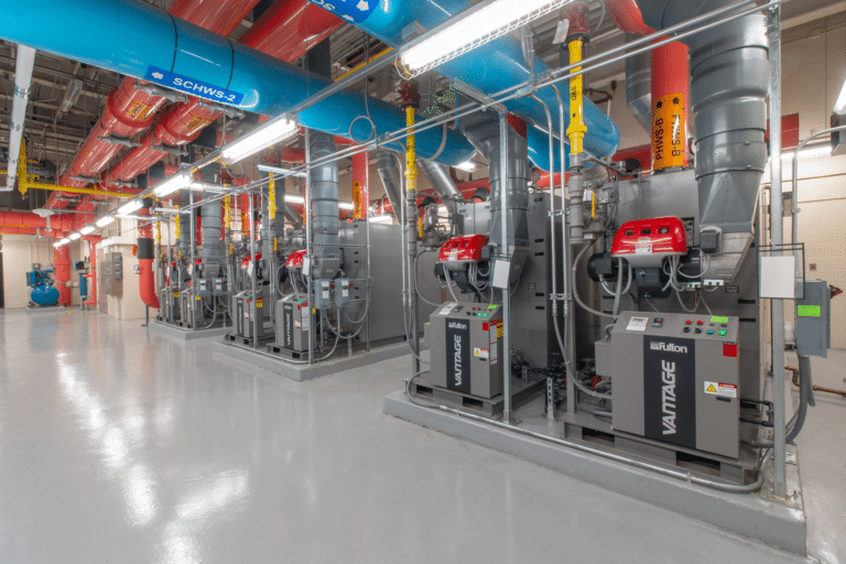 Several Fulton Vantage boilers installed in a clean sub-basement of a commercial facility