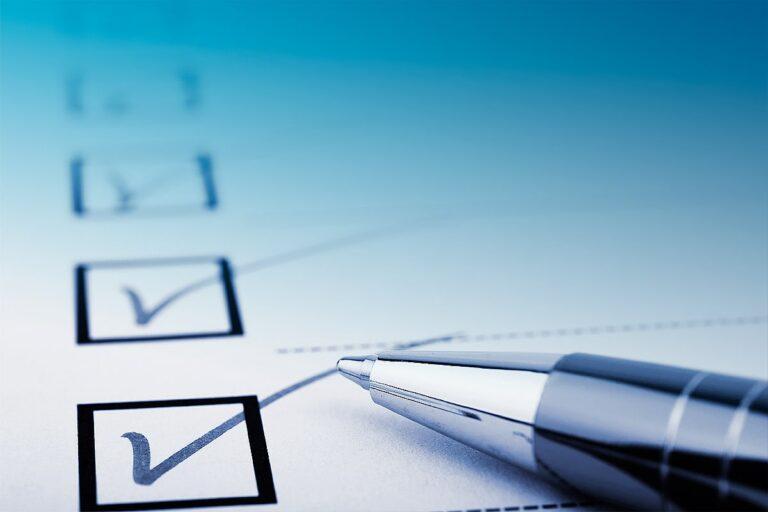 A ballpoint pen and a checklist