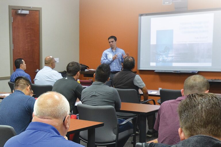 A member of Fulton's management team teaching a classroom full of staff about boiler components