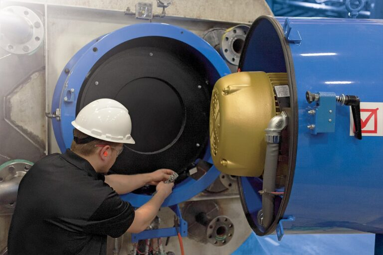 A Fulton certified team member checking over a boiler component
